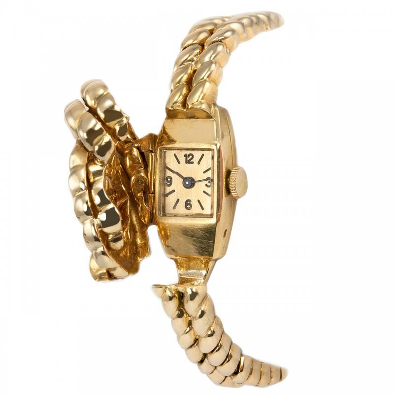 Van Cleef & Arpels Hidden Watch Gold Knot Bracelet, Circa 1960s