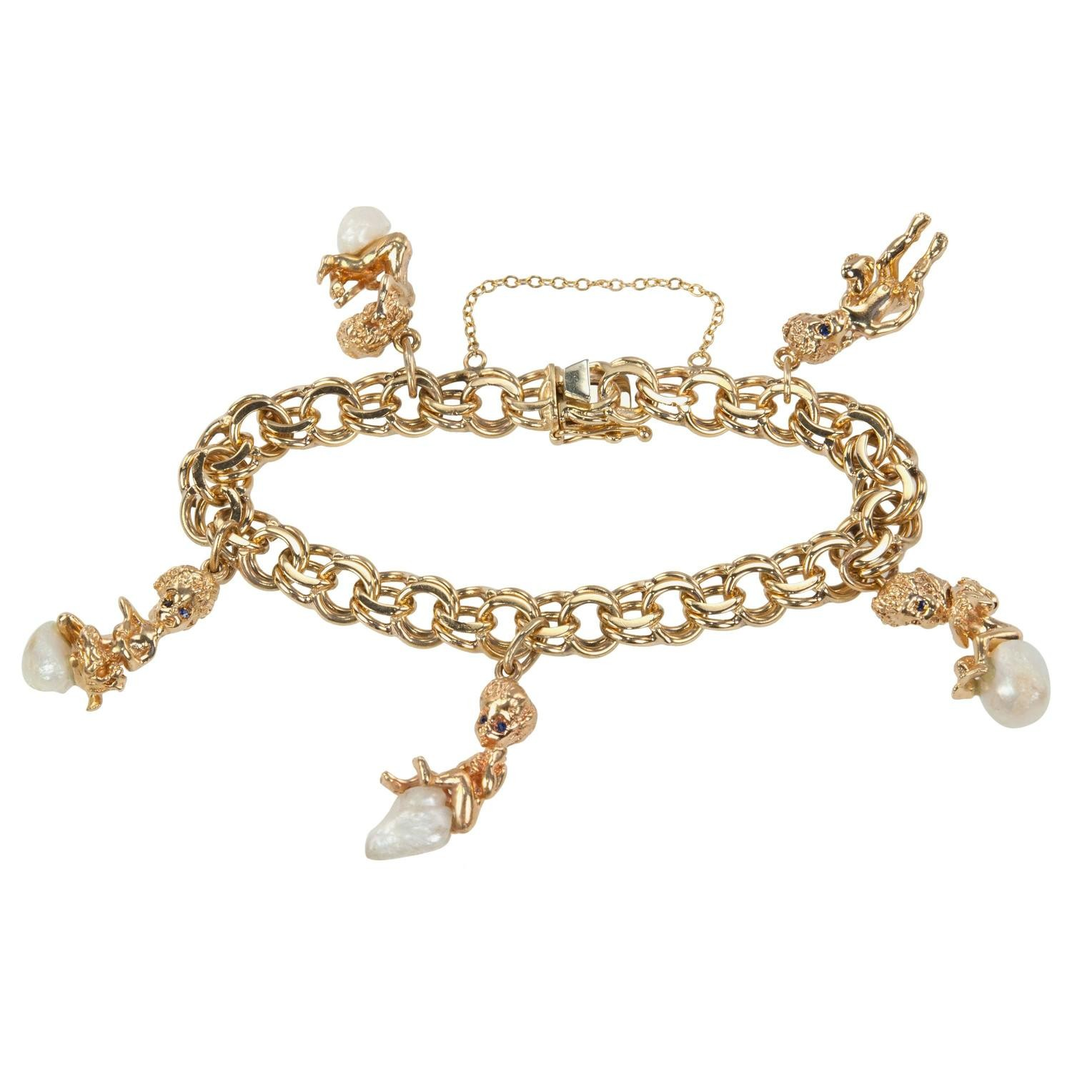 Ruser Gold and Pearl Charm Bracelet